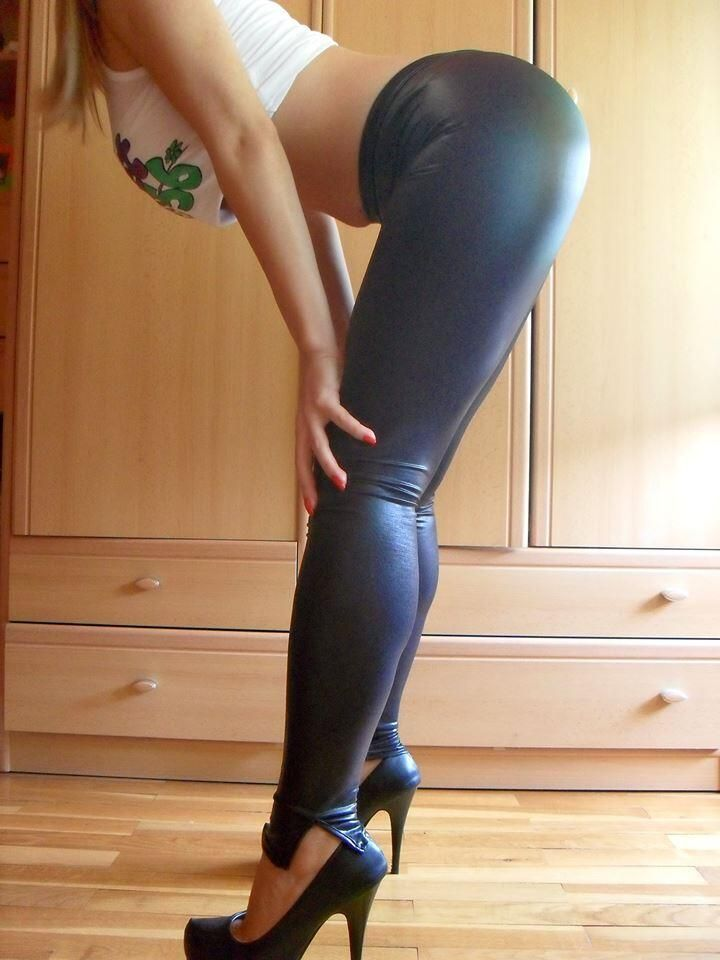 Girls bending over in black dress pants