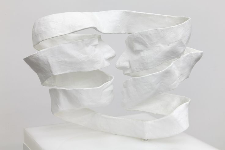 0 twisted Cardboard dipped in resin Sculpture of 2 faces by Barbara Leoniak