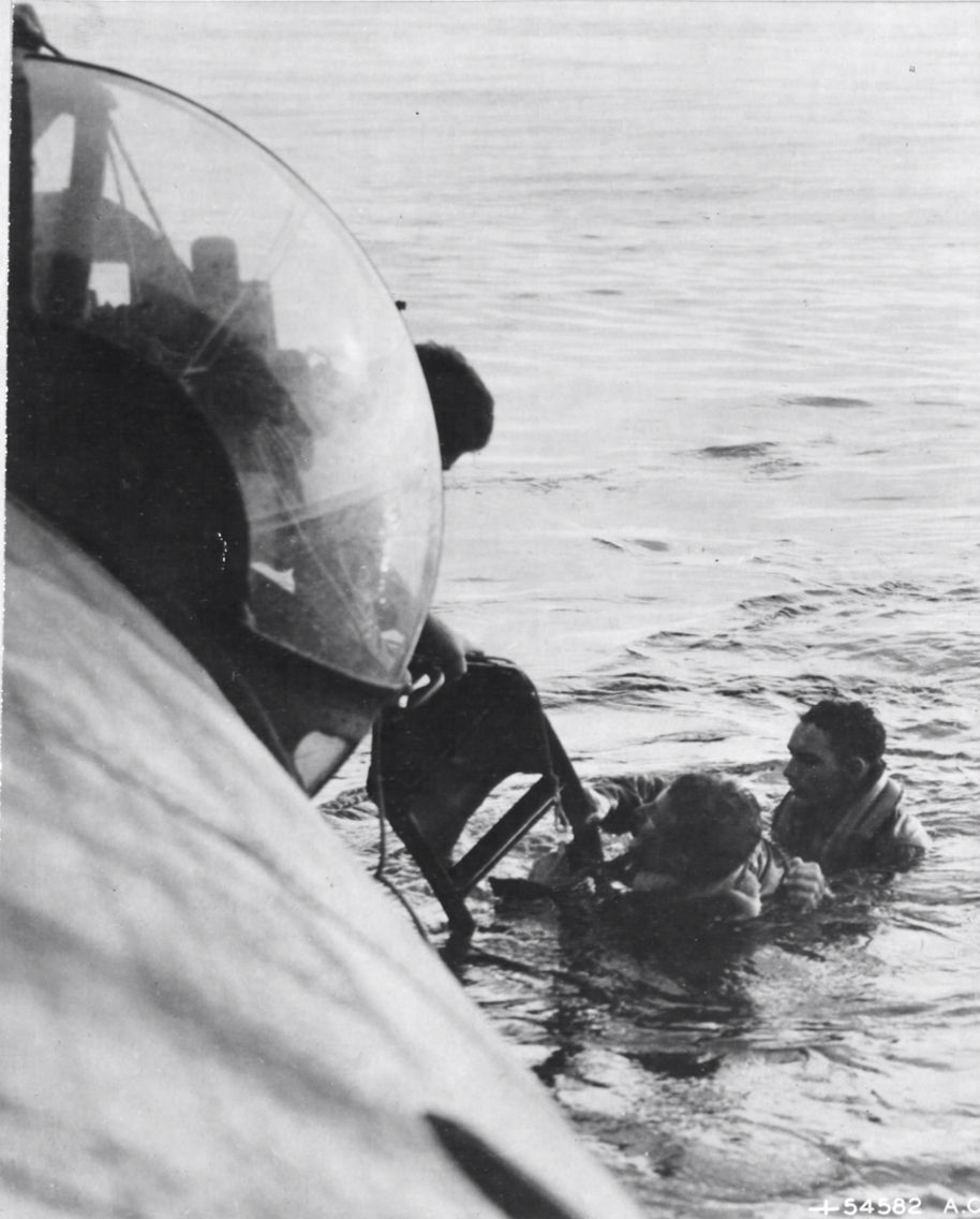 Crew of a PBY Catalina attached to AirSea Rescue work to