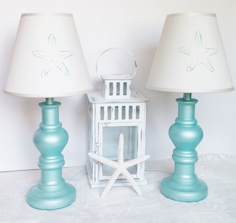 Blue lamp w/ starfish shade. Beach coastal cottage accent