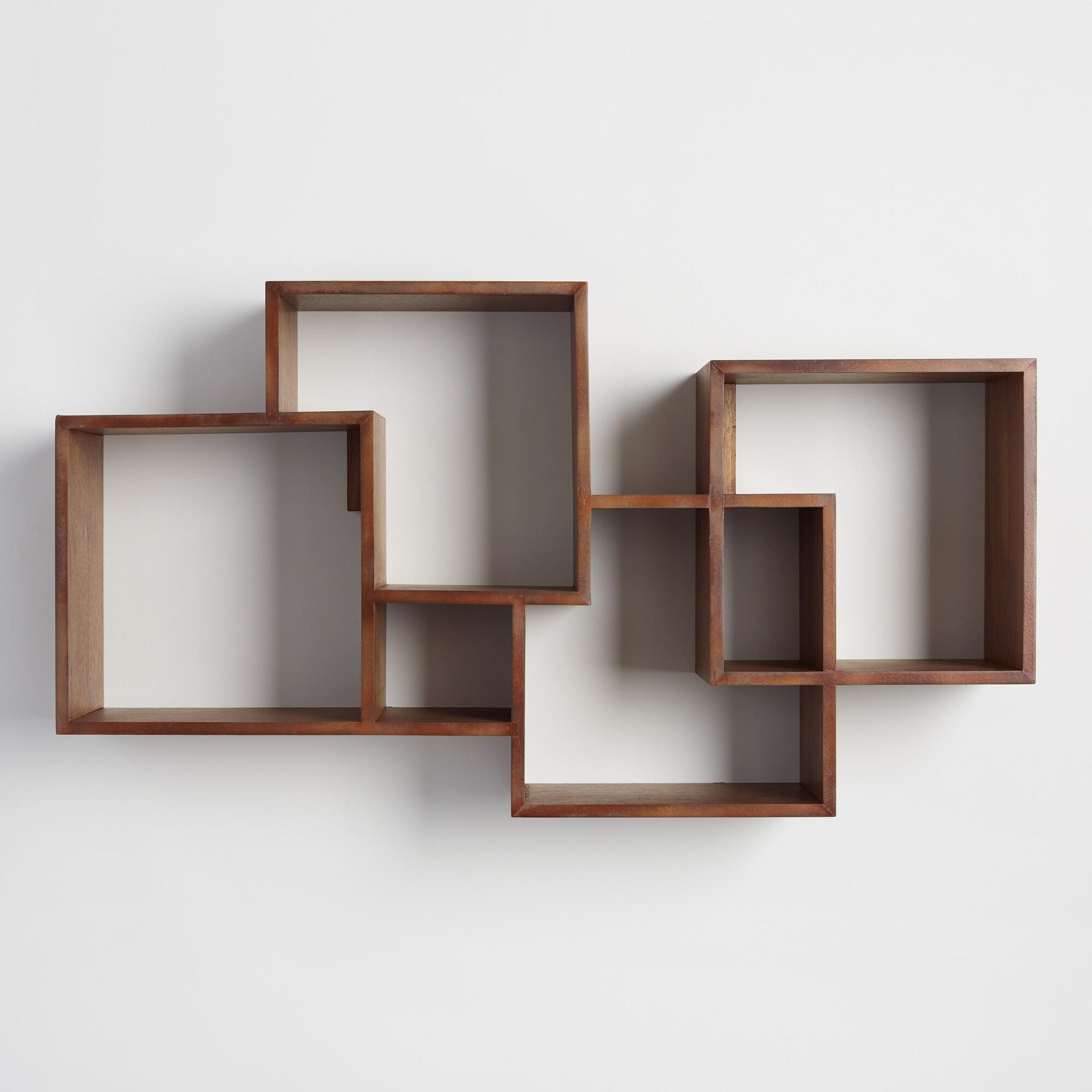 Featuring four cubbies and two smaller niches, this artistic wall-mounted  wood shelf with