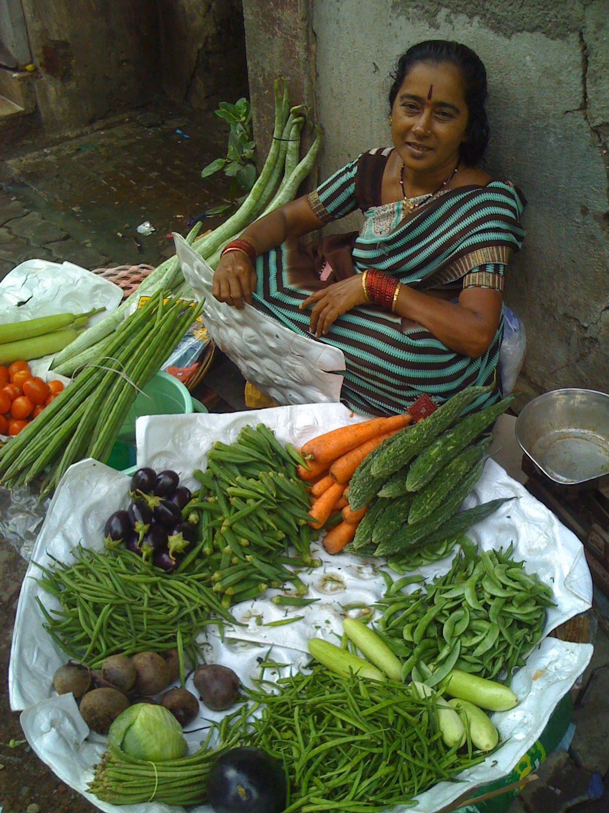 Vegetable vendor in public market, Bandra West, India