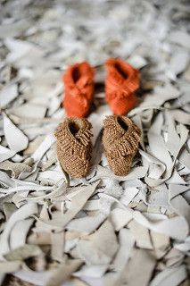These slipper-booties are part of the New Guy layette collection from Tot Toppers and are shown with the coordinating pieces of the set. New Guy is available as a booklet or an e-book and the patterns are now available individually as well.