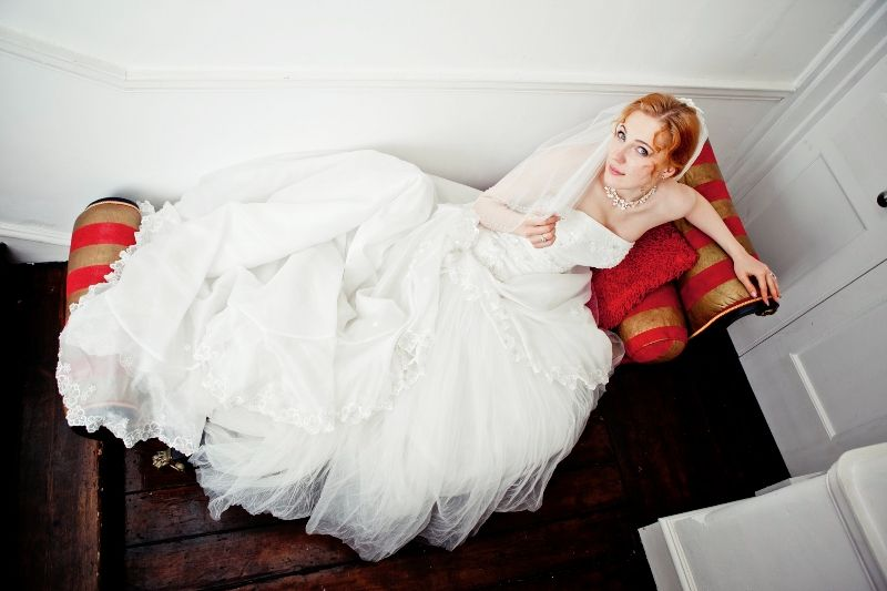 Bride on a vintage sofa  Agnes Photography & Film www.agnesphotoandfilm.co.uk