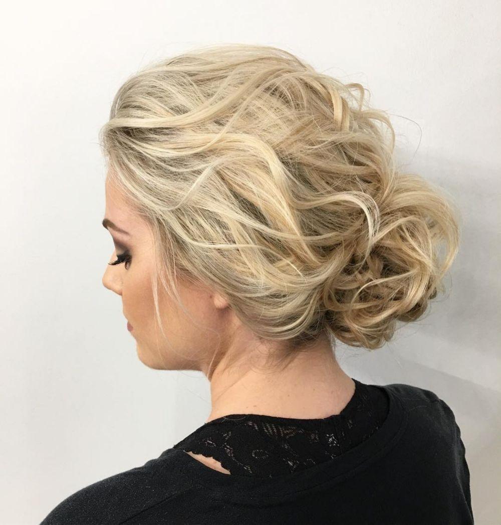 wavy pulled back bun  medium hair styles updos for