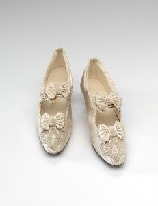 Moubray, Rowan & Hicks, Melbourne (retailer)  1878–92  England (manufacturer)  Shoes (c. 1892)  silk, leather, paste pearl  (a-b) 9.5 x 5.5 x 23.0 cm (each)  National Gallery of Victoria, Melbourne  Gift of Mr J. G. H. Sprigg, 1971