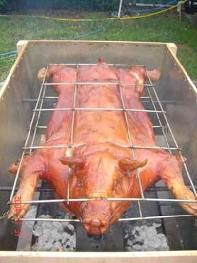 whole roasted pig in a caja china traditional cuban christmas eve main course - Cuban Christmas Traditions