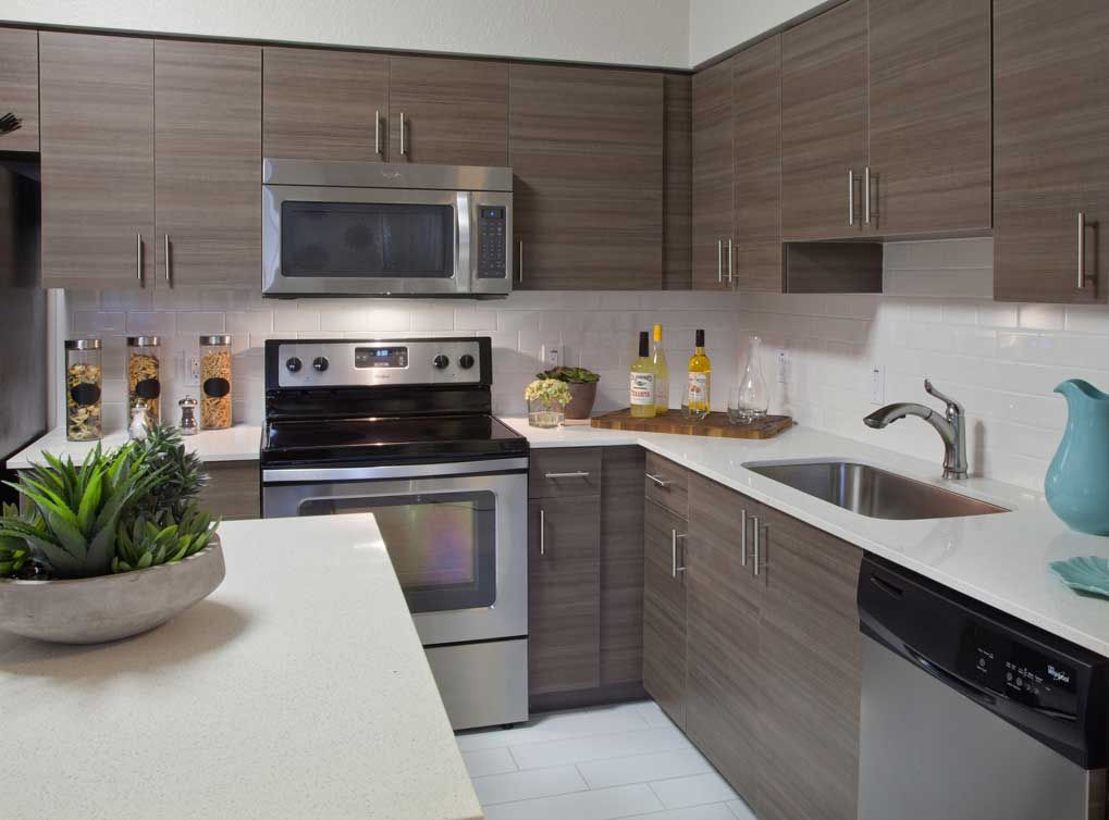 Designer Kitchen Cabinets, Tile Backspashes, And Elegant Quartz Countertops  Are What You Can Expect