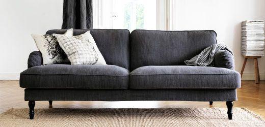 A Large Grey Sofa With Checked Cushions In A White Room Con Immagini Arredamento Casa Divani Case Mobili