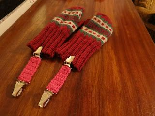 Crocheted holders for mittens.