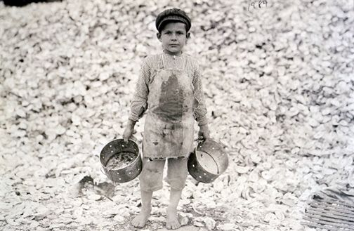 "Lewis W. Hine  American (1874-1940)  TITLE ON OBJECT: Mississippi cannery, Shrimp picker - 5 years old  SERIES TITLE: ""Child Labor (Canneries)""  1911"