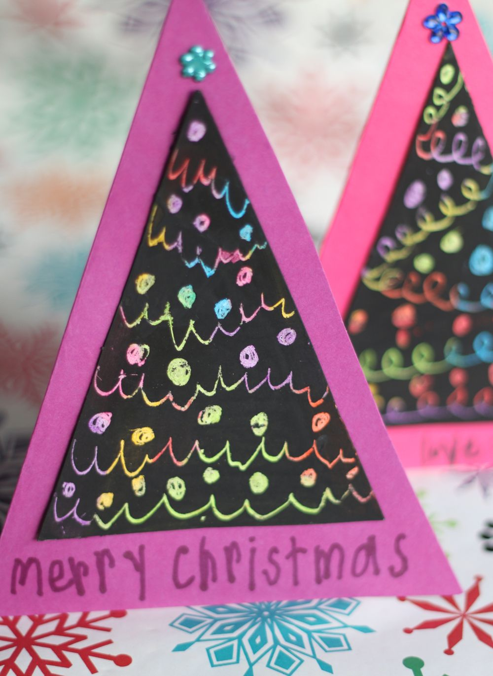 A finished Christmas tree scratch art card.                                                                                                                                                     More