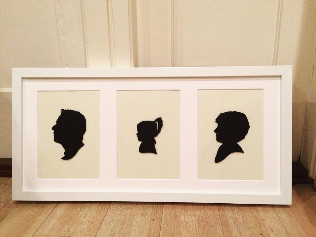 Custom Family Silhouette Portrait in Triple White Box Frame #silhouette #silhouettes #family #familyportrait #familyart #wallart #modernart #familyhome #home #present #gift #bespoke #unique #guesswho #framedart #madeinengland #blackandwhite #familie #love #children #kids #childrenart