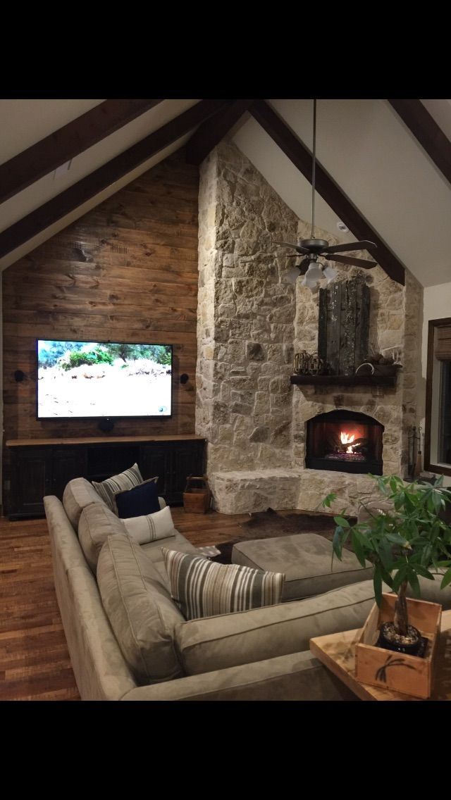 Gorgeous Stained Shiplap Complimenting A Stone Corner Fireplace Simple Fireplace Fireplace Design Fireplace Surrounds