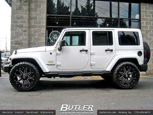 White Jeep Wrangler With Chrome Rims