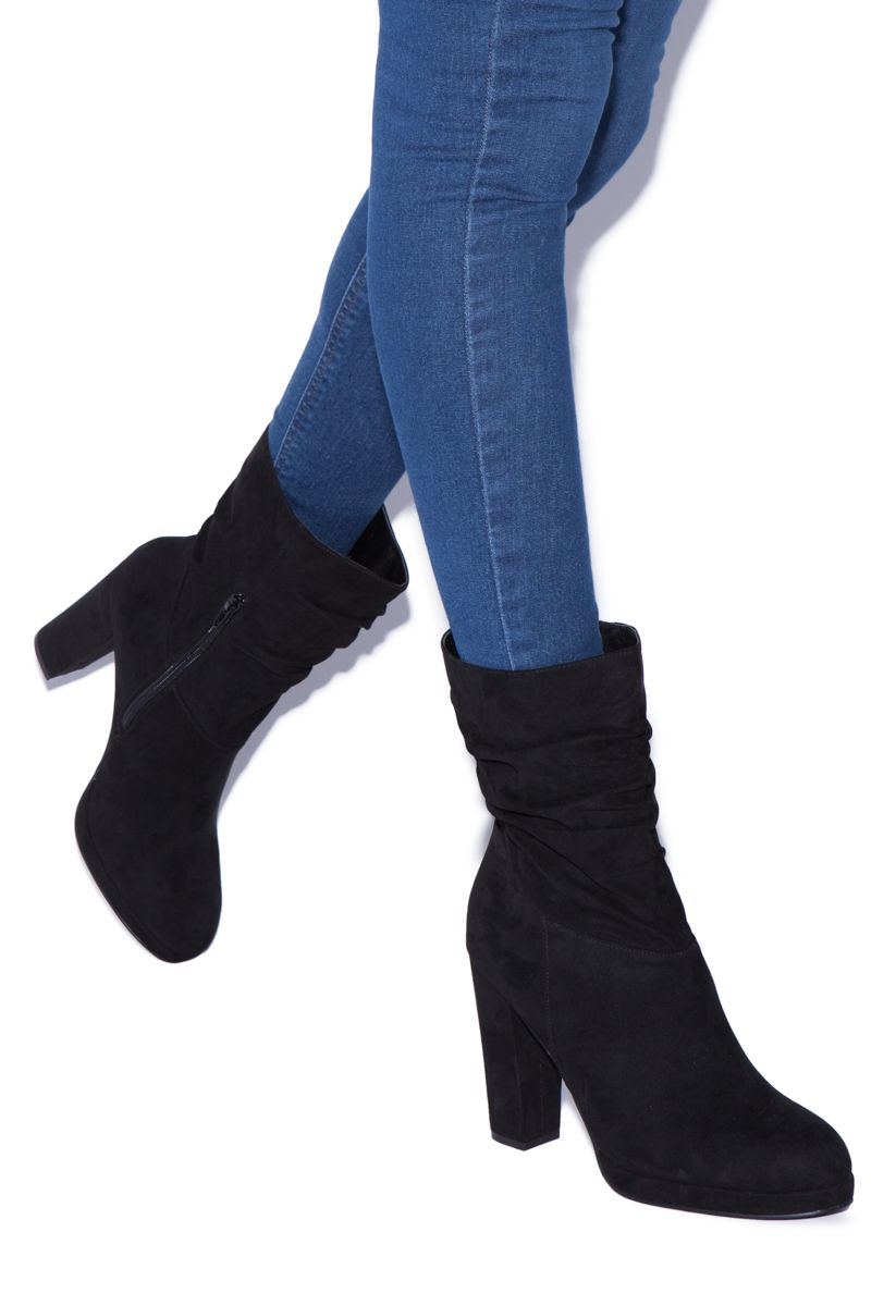 748d10fadc7 Jeans and a sweater makes this slouchy bootie daytime appropriate ...