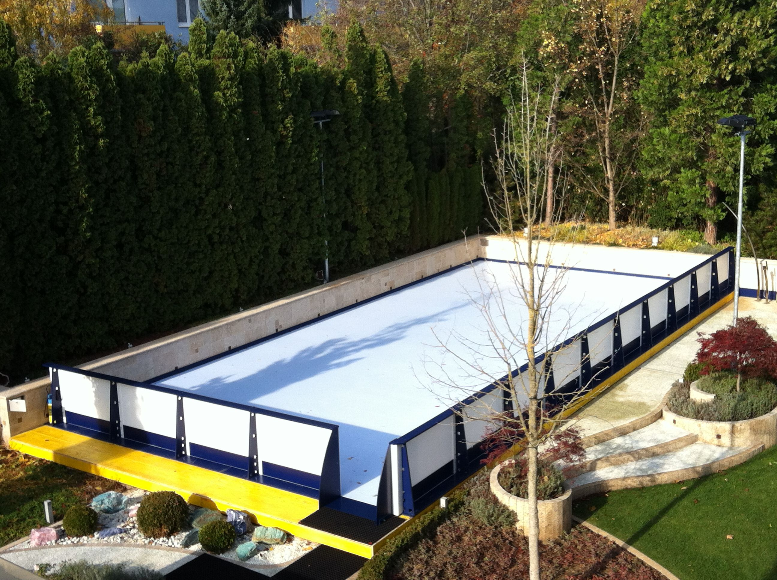 backyard synthetic ice rink built over a pool in vienna home