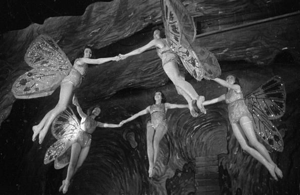 24th December 1943: A group of actresses in the roles of Neverneverland fairies in a London stage production of 'Peter Pan' are hoisted aloft by Joseph Kirby's invisible flying wires. Original Publication: Picture Post - 1608 - Mr Kirby's Flying Ballet - pub. 1943 (Photo by Kurt Hutton/Picture Post/Getty Images)