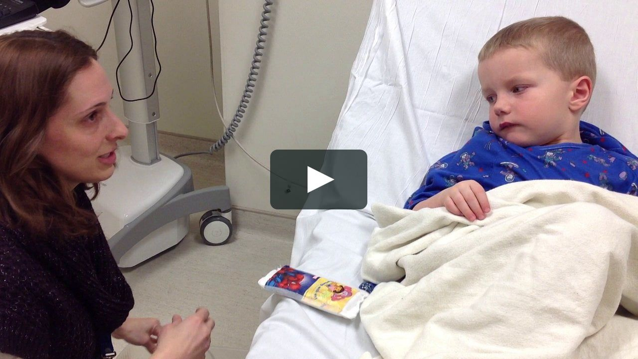 Mindy Teele, a child life specialist, explains an IV start