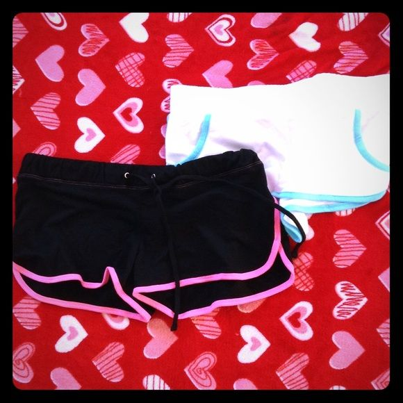 BUNDLE OF TWO COTTON SHORTS One black with pink piping and the other white with turquoise piping. The white has pockets and the black doesn't have pockets.the black it's a large and the white is a medium. Black is a forever 21 brand and the white is a no boundaries brand. Shorts