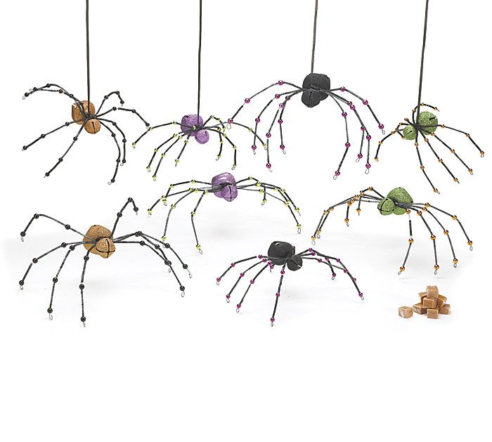 "#burtonandburton Tin bell spiders with wire and ornamental legs.Large: 4""H X 13""W X 7""D.Small: 4 1/2""H X 8""W X 5""D.4 Sets of 2. Total of 8 spiders."