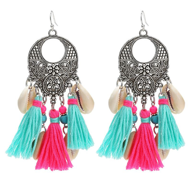 Big crafted gypsy earrings with colorful tassels and shells. www.yehwang.com