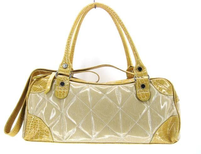 $22.99  Fashion Handbag White  SIZE L14 W4 H9        High quality synthetic leather with dual shoulder strap. Top zipper closure and rear zipper pocket. Full lined interior with compartments. Colored studs decorate the front. Additional long shoulder strap.