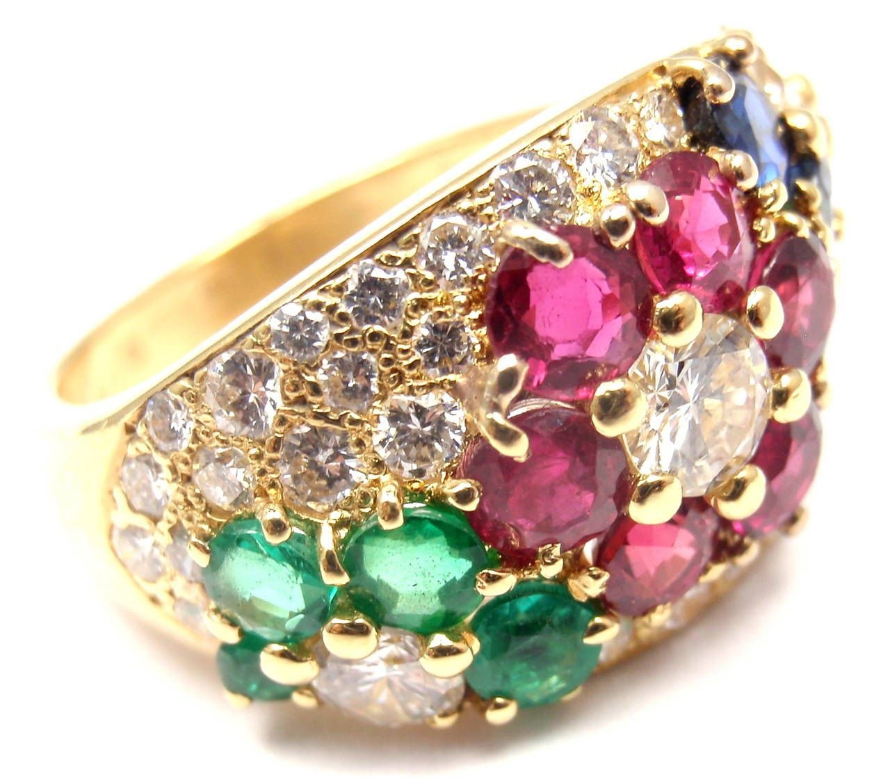Van Cleef & Arpels Ruby Emerald Sapphire Gold Ring   From a unique collection of vintage cocktail rings at https://www.1stdibs.com/jewelry/rings/cocktail-rings/