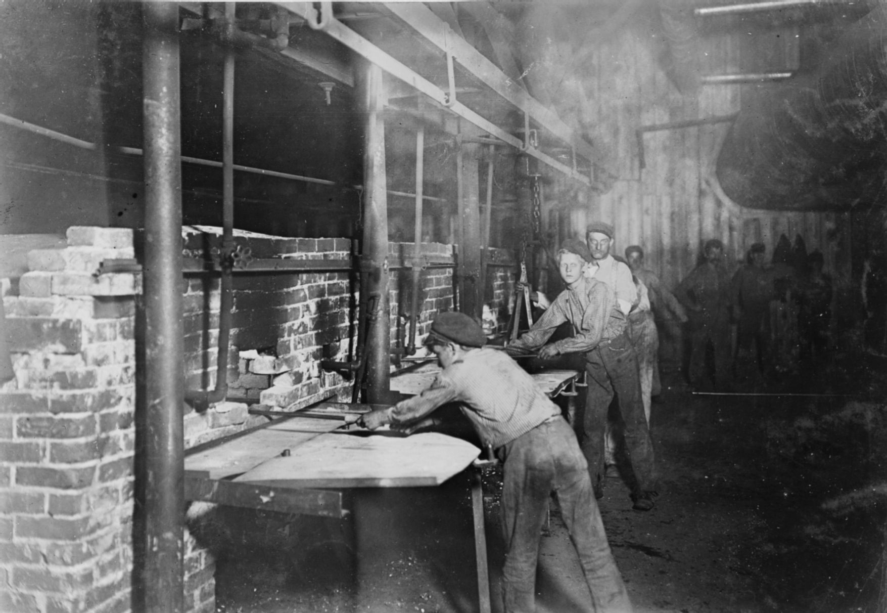 CHILD LABOR Late night shift at the glass factory. The