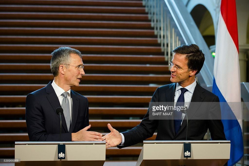 Secretary General Jens Stoltenberg (L) and Dutch Prime Minister Mark Rutte (R) speak as they shake hands during a joint press conference after a meeting in The Hague, on June 9, 2016 ahead of the NATO Summit in Warsaw on 8 and 9 July. / AFP / ANP / Bart Maat / Netherlands OUT