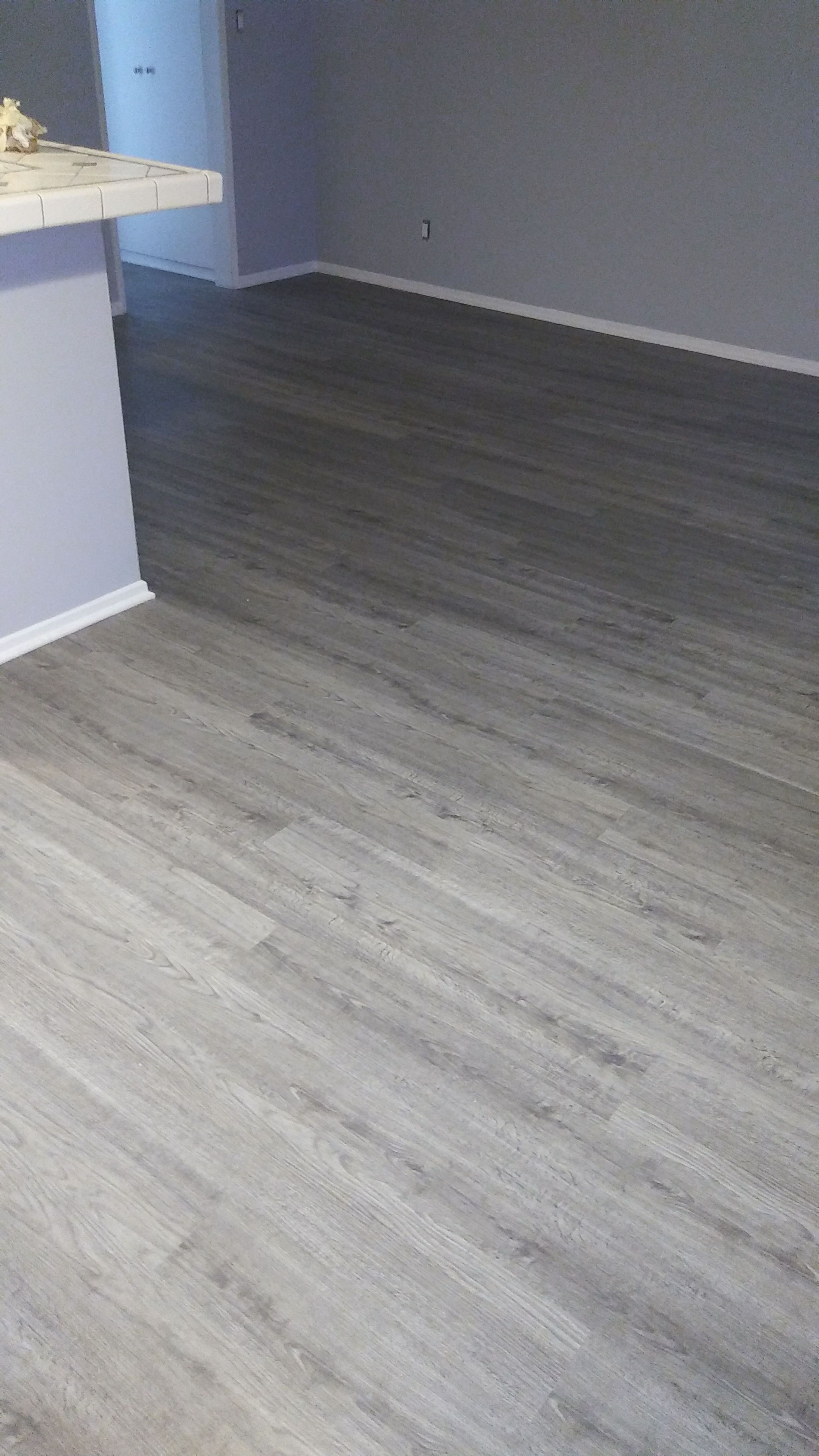 Here S A Vinyl Plank Flooring Installation In Rockport Grey Color It S One Of Our Stock Col Grey Vinyl Plank Flooring Vinyl Plank Flooring Grey Vinyl Flooring