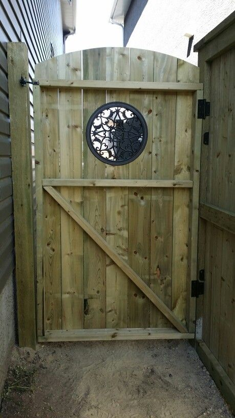 cast iron insert on a pressure treated gate with z brace below for strength