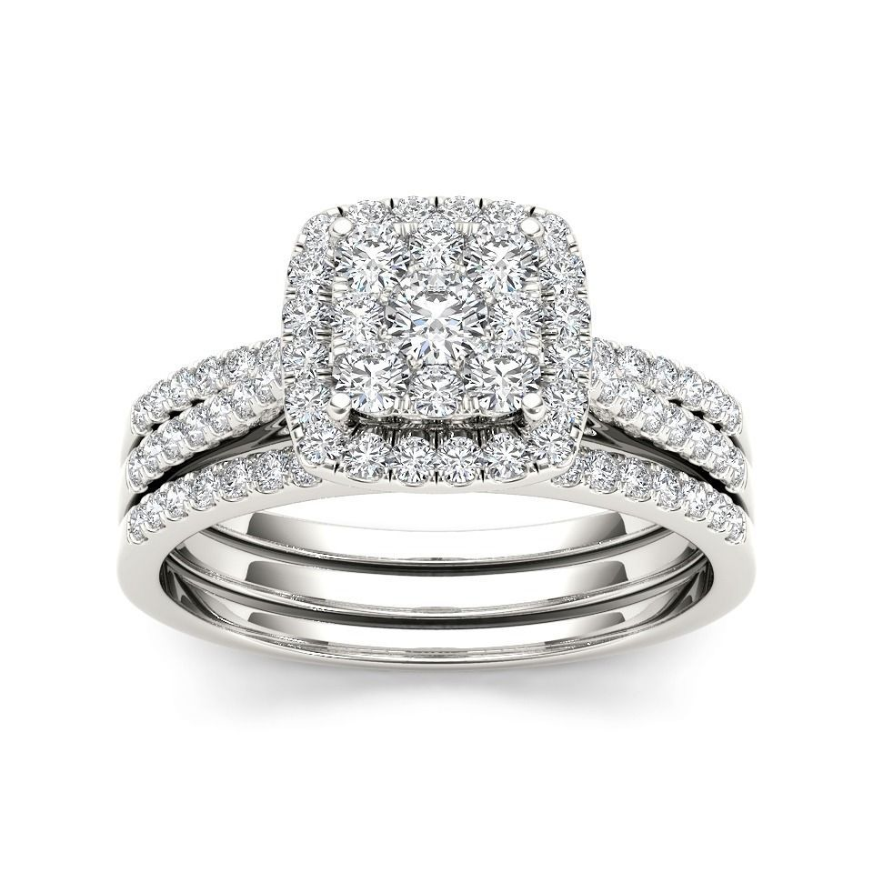 This round-cut diamond bridal ring set will always remind the one you love of that special day in your lives. Rows of diamonds are spectacularly arranged in 10-karat white gold that sets off the beauty of the stones while resisting dings and dents.