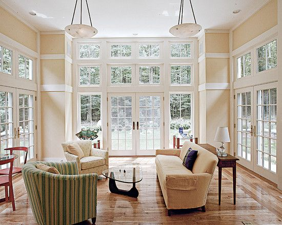 Two Story Great Room With Windows Trim To Break Up Height Of