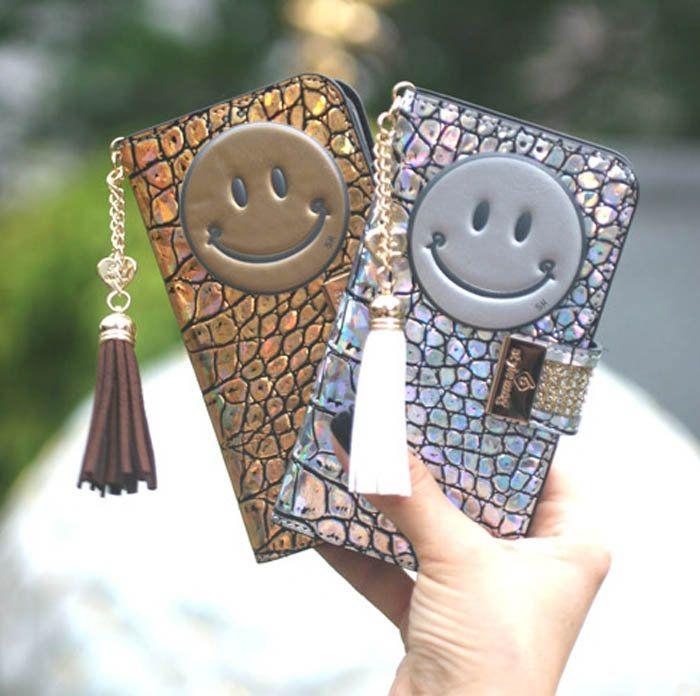 94b010188b 楽天市場】にっこり笑うニコちゃんスマイルとゴージャスな質感の手帳型 ...