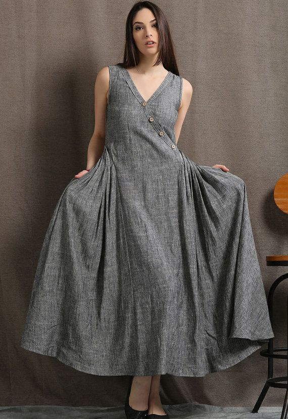 c6cb28eeaa6 A flattering gray linen maxi dress cut with extra pleated fabric at the  sides that creates additional room perfect for plus size women. The grey  marl is