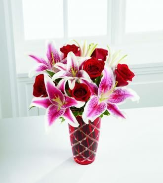 Looks like my wedding boquet! Red roses and Stargazer Lillies!