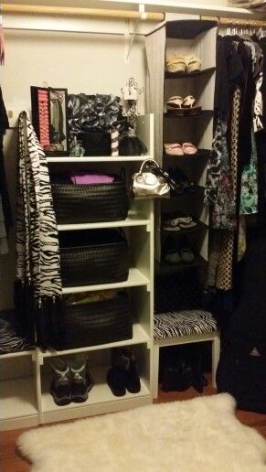 Simple shelving and black baskets does the trick