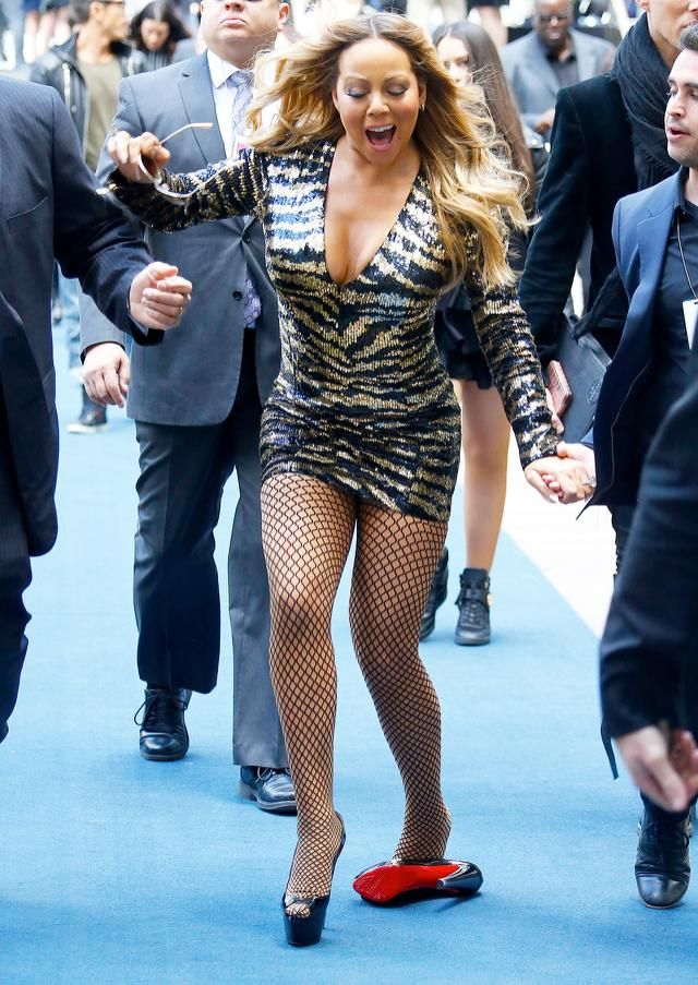 2fa94a3ee91d How Many Handlers Does It Take to Help Mariah Carey Get Her Shoe ...