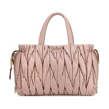 Matelassé Large Double Handle Tote Bag by Miu Miu. Miu Miu tote bag in  patent matelass leather with golden hardware. Rolled top handles. f9eb39405e