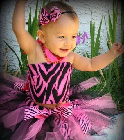 3 Pc Hot Pink & Black Zebra Tutu Set. The tutu is made out of white tulle hand-tied to a 3/4 inch non roll elastic. The matching top is made out of zebra print fabric and hot pink cotton lining accented with hot pink satin ribbon lace on the back & ribbon tie on the neck. Good for photo props, parties, gatherings or just adorable time at home. You can either pair the top with either of these tutus without the headband and ribbons