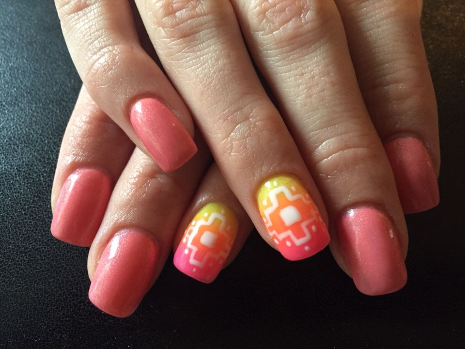 New set acrylic nails with pink/glitter gel polish and an ombré Aztec nail art.
