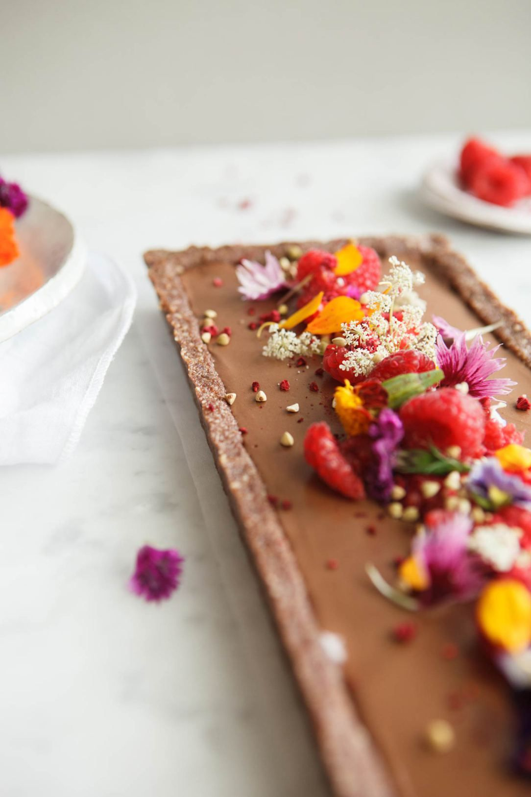 Home cooked chocolate tart decorated with fresh berries and a simple raw chocolate raspberry tart recipe entirely vegan and gluten free the perfect valentine day treat forumfinder Gallery