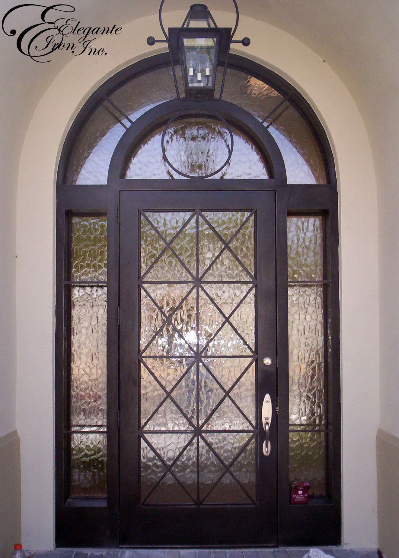 Custom wrought iron door with surround