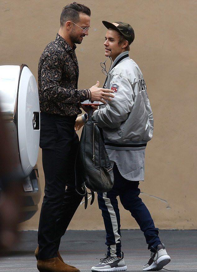 f38ede08 Justin Bieber With Carl Lentz Wearing Raiders Jacket, Fear Of God ...