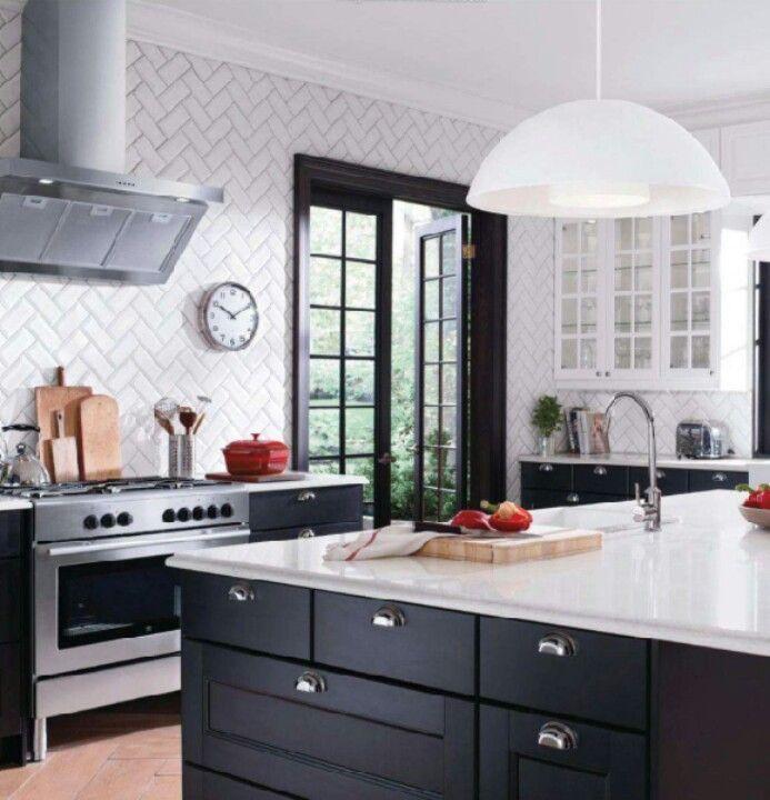 Ikea kitchen, herringbone tile, black bases, white countertops