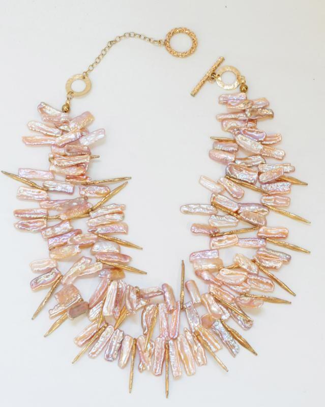 Double-strand pearl necklace.  Harri B.