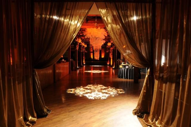 Masquerade theme like the idea of curtains draping for How can prom venues be decorated