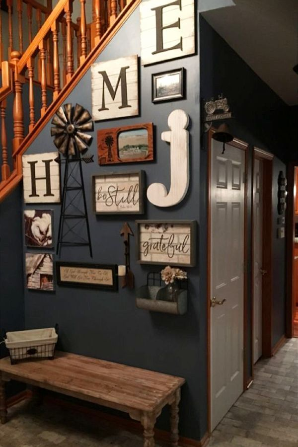 LOVE this small foyer DIY decorating idea - one of my favorite foyer wall decor ideas so far PP3132019 Such a pretty farmhouse style foyer accent wall for by the stairs! This page has the best small foyer decorating ideas I've found so far.