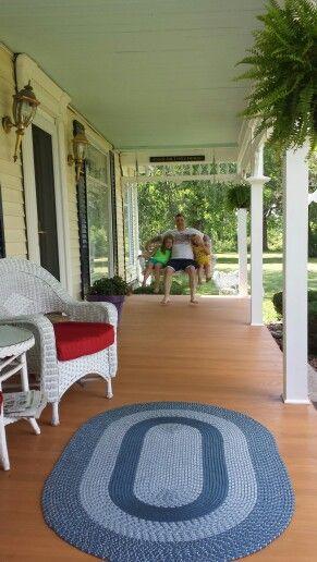 Restored 1840's porch.  Ceiling color Grand Hotel Mackinac valspar floor cedar naturaltone Behr.